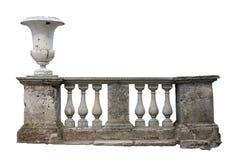 Baluster Railing. Abandoned ancient stone baluster railing with old vase isolated on white background royalty free stock image