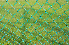 Baluster steel with green grass background. Texture royalty free stock photo