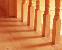 Baluster. Wooden baluster at the bottom of a staircase stock photo