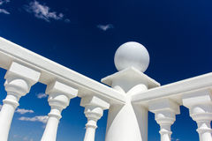 Balusters on the railing. And blue sky with clouds Royalty Free Stock Photography