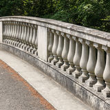 Balustrade. Part of a stone bridge seen at Exbury Gardens in the New Forest stock image