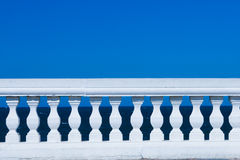 Balustrade on blue. White balustrade by the sea in North Spain Stock Photos