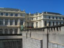 Balustrade, contrast old-new. Secluded Brussels museum square uptown, with old 18-th century buildings: Palace of Charles de Lorraine. The National Museum is in Stock Photo