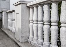 Balustrade from gray granite. Elements of city architecture. Classic architecture royalty free stock photos