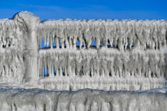 Balustrade with icicles after freezing rain Stock Photos