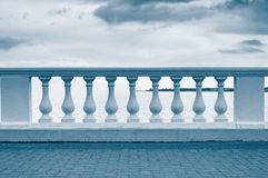 Balustrade on sea shore. And cloudy sky royalty free stock images