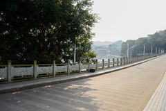 Balustraded raod on dam in sunny winter afternoon Royalty Free Stock Image