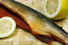 Balyk of a humpback salmon with a lemon Royalty Free Stock Photos