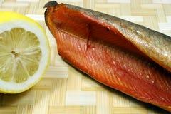 Balyk of a humpback salmon with a lemon Royalty Free Stock Photo