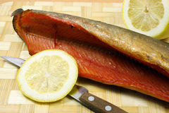 Balyk of a humpback salmon with a lemon Royalty Free Stock Photography