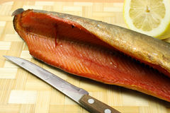 Balyk of a humpback salmon with a lemon Stock Photos