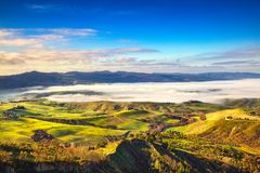 Balze of Volterra foggy morning panorama, farmlands and green fields. Pisa, Tuscany, Italy. royalty free stock images