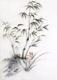 Bambú y orquídea Imagenes de archivo