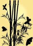 Bambú y mariposas en amarillo Imagenes de archivo