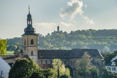 Bamberg cityscape with a Church and a castle in the background belfry in Bavaria, Germany. Stock Photos