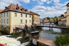 Bamberg, Germany. Dams, bridges, old houses on artificial islands and banks of the river Regnitz Royalty Free Stock Image