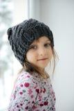Bambina adorabile in knit grigio Fotografia Stock