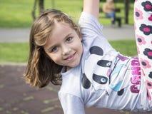 Bambina al campo da giuoco Fotografie Stock Libere da Diritti
