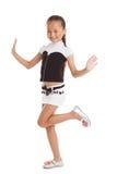 Bambina allegra che posa in vestiti alla moda immagini stock