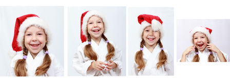 Bambina allegra quattro anni con il beanie di Santa Claus sulla sua testa Fotografie Stock