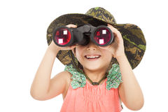Bambina asiatica sorridente che guarda tramite il binocolo Fotografia Stock
