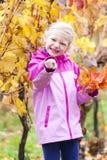 Bambina in autunno Immagine Stock