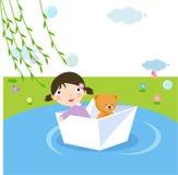 Bambina in barca di carta Fotografia Stock