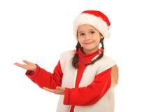 Bambina in cappello di natale Fotografia Stock