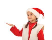 Bambina in cappello di natale con una mano vuota Fotografie Stock