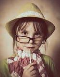Bambina in cappello e vetri Fotografia Stock