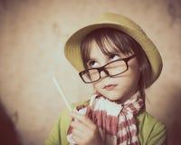 Bambina in cappello e vetri Fotografie Stock