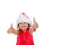 Bambina in cappuccio rosa del Babbo Natale con i pollici su Fotografie Stock Libere da Diritti
