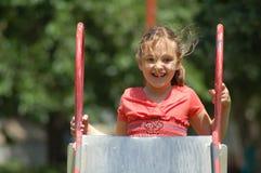 Bambina che arrampica in su trasparenza Fotografia Stock