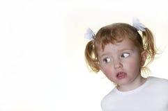 Bambina che fa i fronti 11 Immagine Stock