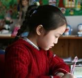 Bambina che fa lavoro nel paese Immagine Stock Libera da Diritti