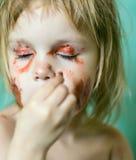 Bambina che fa trucco Fotografia Stock Libera da Diritti
