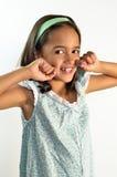Bambina che Flossing i suoi denti Fotografia Stock Libera da Diritti