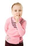 Bambina che gesturing il segno di silenzio Immagini Stock
