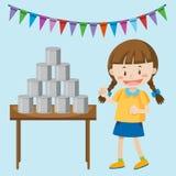 Bambina che gioca le latte alla fiera Fotografia Stock