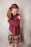 Bambina che imbroglia nello studio Fotografia Stock