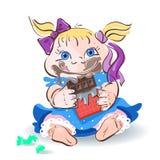 Bambina che mangia cioccolato in un involucro rosso accanto alla caramella Immagine Stock