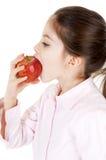 bambina che mangia mela una 库存照片
