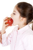Bambina che mangia una mela Stock Photo