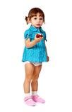 Bambina che mangia una mela Fotografia Stock