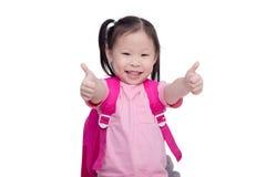 Bambina che mostra i pollici su ed i sorrisi Fotografia Stock Libera da Diritti