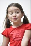 Bambina che soffia un bacio Immagini Stock