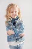 Bambina che sta le sue armi attraversate Immagine Stock Libera da Diritti