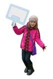 Bambina che tiene un cartello vuoto fotografia stock