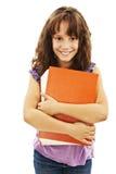 Bambina che tiene un grande libro. Fotografia Stock
