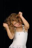 Bambina che tira capelli Fotografia Stock